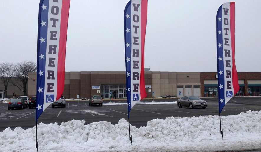 Signs indicate a Franklin County, Ohio, early voting center in Columbus, Ohio., Wednesday, Feb. 17, 2016. Wednesday is the first day that Ohio residents can vote for candidates in the swing state's March 15 primary contests, either by mail or in person without giving any reason. (AP Photo/Julie Carr Smyth)