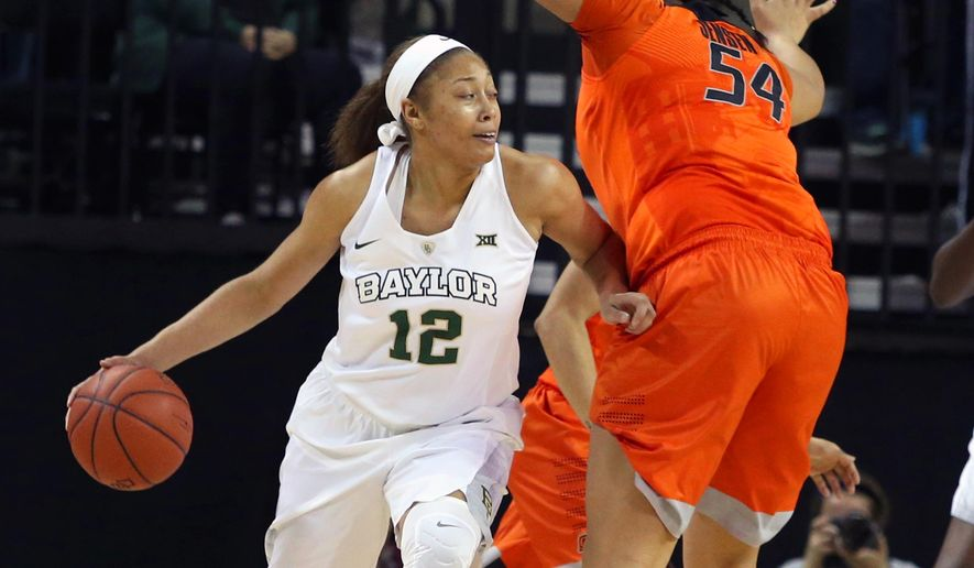Baylor guard Alexis Prince, left, drives past Oklahoma State center Kaylee Jensen, in the first half of an NCAA college basketball game, Wednesday, Feb. 17, 2016, in Waco, Texas. (AP Photo/Jerry Larson)