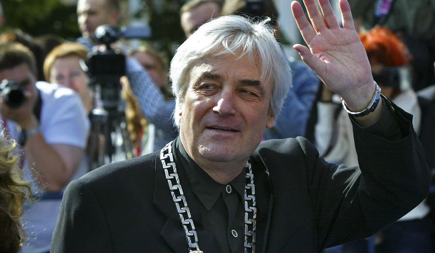 FILE - This is a  Sunday, July 2, 2006 file photo of Polish movie director Andrzej Zulawski, who is chairing the competition jury for the 28th Moscow international film festival,  waves as he arrives for the festival's closing ceremony, Moscow.  Polish film authorities said Wednesday Feb. 17, 2016 that filmmaker and writer Andrzej Zulawski, former partner of actress Sophie Marceau, has died after a long illness. He was 75.  (AP Photo/Misha Japaridze, File)