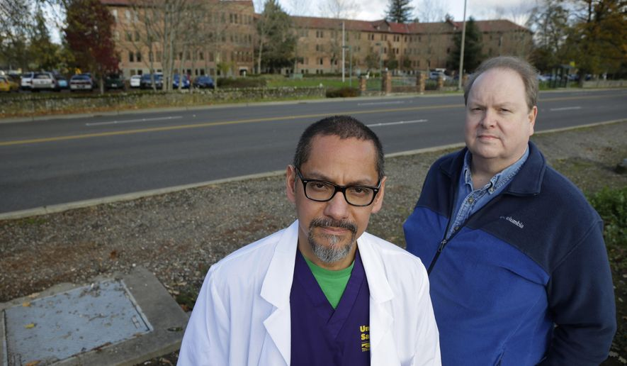 FILE - In this Nov. 19, 2015, photo, Dr. Joseph Wainer, left, a psychiatrist at Western State Hospital, and Paul Vilja, right, a nursing supervisor, pose for a photo near the facility in Lakewood, Wash. Wainer, a hospital psychiatrist who recently resigned as Western State Hospital's Chief of Medical Staff, said Wednesday, Feb. 17, 2016, that two psychiatrists who had criticized hospital management were told to work from home this week during a period when federal inspectors were expected to visit. (AP Photo/Ted S. Warren, file)