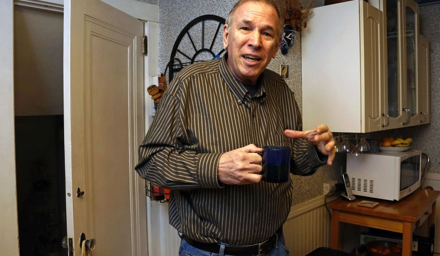 """Dave Bostick has a cup of tea in the kitchen of his home in Pittsburgh, Tuesday, Feb. 16, 2016. Bostick, 71, a retired vocational rehab counselor, said his low mood and energy level improved """"a little bit"""" during a testosterone treatment study but suddenly worsened afterward. He said he has resumed using testosterone at his doctor's recommendation and isn't overly concerned about the potential risks. Something's going to get me sooner or later,"""" Bostick said. (AP Photo/Gene J. Puskar)"""