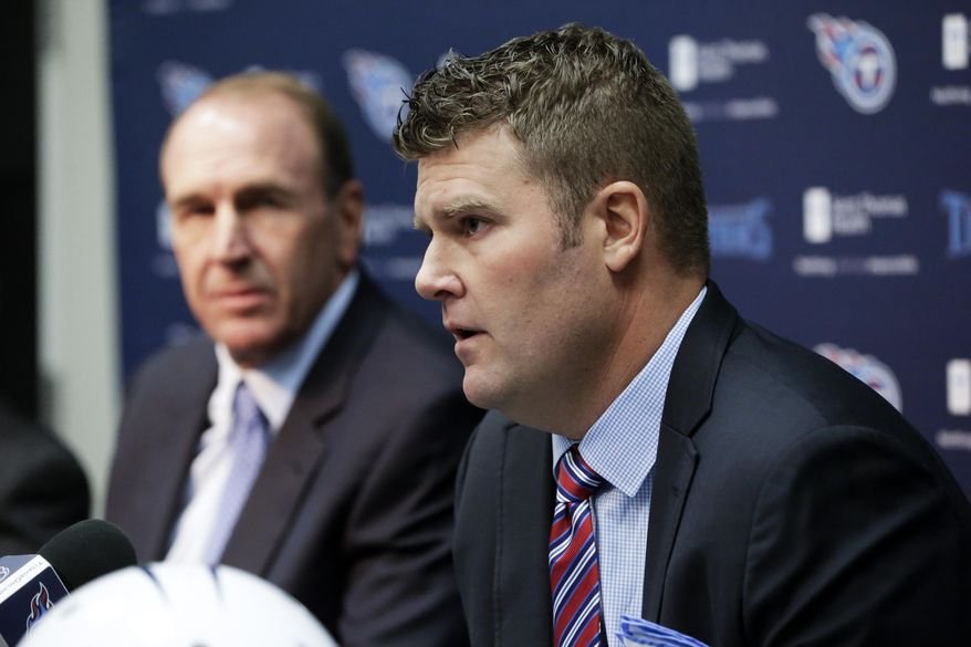 FILE - In this Jan. 18, 2016, file photo, Tennessee Titans general manager Jon Robinson, right, and head coach Mike Mularkey answer questions at a news conference in Nashville, Tenn. Jon Robinson has been very busy since being hired as Tennessee's new general manager. He's had to study the Titans' current players, prep for the start of free agency and the NFL Combine holding the No. 1 pick overall in the April draft.  (AP Photo/Mark Humphrey, File)