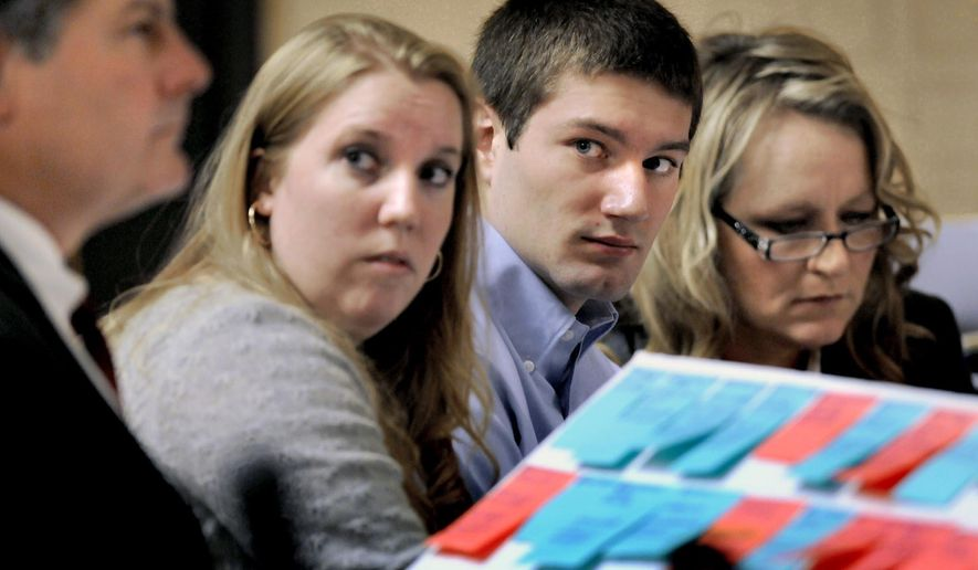 FILE - In this Feb. 8, 2013, file photo, former University of Montana quarterback Jordan Johnson, second from right, sits with his defense team during jury selection in Missoula, Mont. Montana will pay the former quarterback about $245,000 to drop his claims that school officials mishandled a rape investigation against him that drew national attention, according to a settlement agreement approved Tuesday, Feb. 16, 2016. (Kurt Wilson/The Missoulian via AP, File) MANDATORY CREDIT