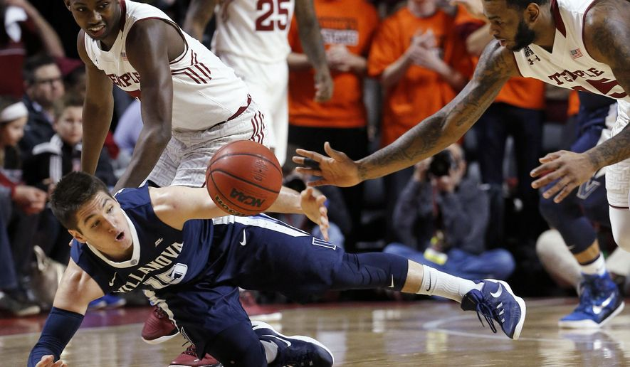 Villanova's Ryan Arcidiacono, left, dives for a loose ball against Temple's Jaylen Bond, right, as Levan Shawn Alston Jr. watches during the first half of an NCAA college basketball game Wednesday, Feb. 17, 2016, in Philadelphia. (AP Photo/Matt Slocum)