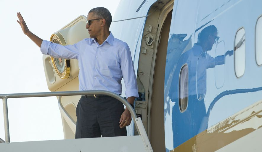President Obama waves as he boards Air Force One. (Associated Press)