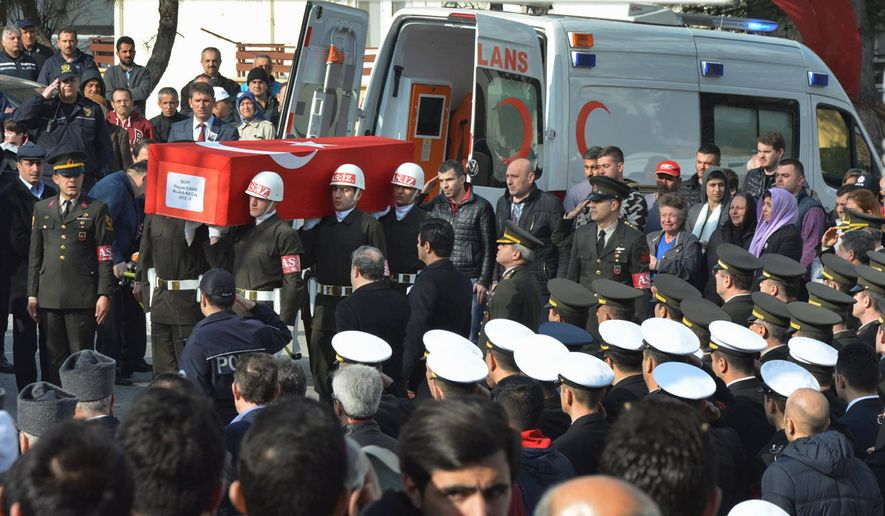 Turkish soldiers Thursday mourned Sgt. 1st Class Feyyaz Ilhan, one of the 28 people killed in an Ankara explosion Wednesday. The attack, blamed on a Kurdish group, raised tensions with the U.S. (Associated Press)