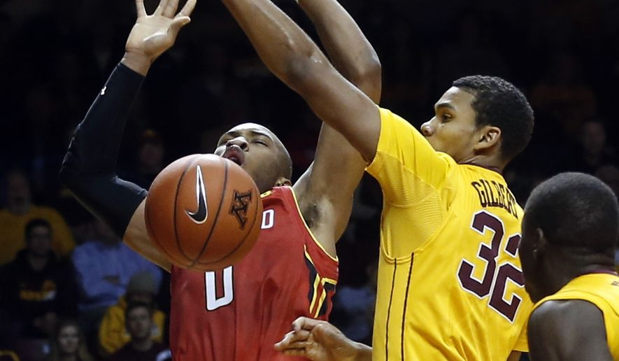 Maryland's Rasheed Sulaimon, left, loses the ball after Minnesota's Ahmad Gilbert Jr. knocked it away during the first half of an NCAA college basketball game Thursday, Feb. 18, 2016, in Minneapolis. (AP Photo/Jim Mone)