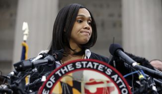 Marilyn Mosby, Baltimore state's attorney, pauses while speaking during a media availability on May 1, 2015, in Baltimore. Mosby announced criminal charges against all six officers suspended after Freddie Gray suffered a fatal spinal injury while in police custody. (Associated Press) **FILE**