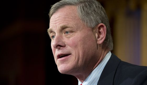Senate Intelligence Committee Chairman Sen. Richard Burr, North Carolina Republican, is working on a bill to criminalize a company's refusal to decipher encrypted communications. (Associated Press)