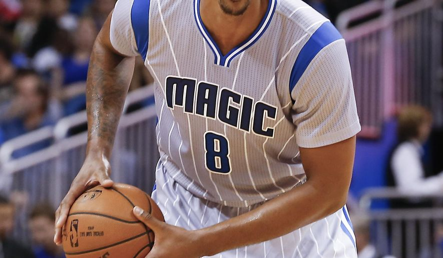 FILE - In this Nov. 27, 2015, file photo, Orlando Magic forward Channing Frye (8) drives during the second quarter of a basketball game against the Milwaukee Bucks, in Orlando, Fla. Two people with knowledge of the deal say the Cavaliers have acquired forward Channing Frye from the Orlando Magic in a trade for popular center Anderson Varejao. The Cavs will send Varejao to Portland in the trade to acquire Frye, said the people who spoke Thursday, Feb. 18, 2016, to the Associated Press on condition of anonymity because the teams are awaiting league approval. (AP Photo/Reinhold Matay, File)