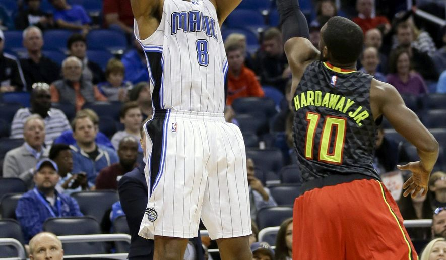 FILE - In this Feb. 7, 2016, file photo, Orlando Magic's Channing Frye (8) shoots over Atlanta Hawks' Tim Hardaway Jr. (10) during the first half of an NBA basketball game, in Orlando, Fla. Two people with knowledge of the deal say the Cavaliers have acquired forward Channing Frye from the Orlando Magic in a trade for popular center Anderson Varejao. The Cavs will send Varejao to Portland in the trade to acquire Frye, said the people who spoke Thursday, Feb. 18, 2016, to the Associated Press on condition of anonymity because the teams are awaiting league approval. (AP Photo/John Raoux, File)
