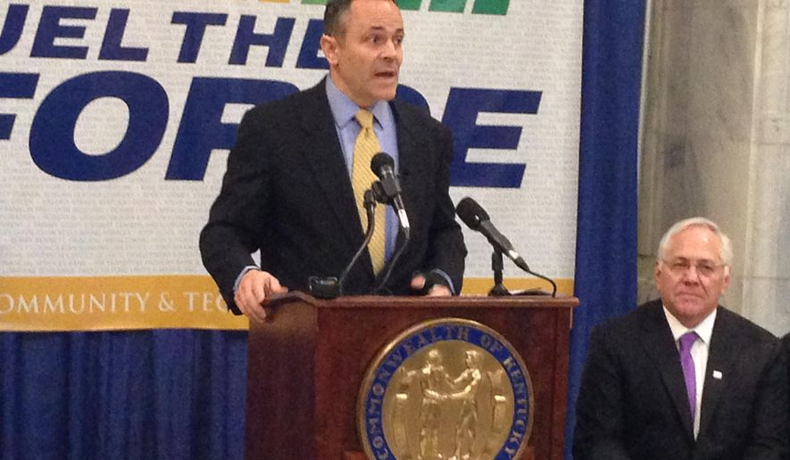 Kentucky Republican Gov. Matt Bevin defends his proposed budget cuts to higher education as Jay Box, the president of the Kentucky Community and Technical College System, listens in Frankfort, Ky., Thursday, Feb. 18, 2016. Box told state lawmakers earlier in the day that Bevin's cuts would require him to raise tuition (AP Photo/Adam Beam)