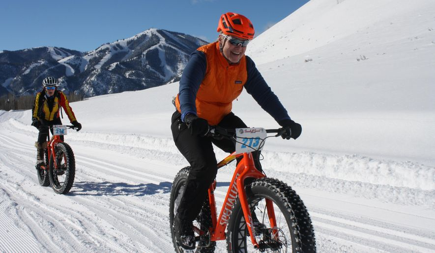 CORRECTS STATE TO IDAHO AND SOURCE TO IDAHO STATESMAN - In this Jan. 30, 2016 photo, Karen Dreher, right, and Nicole Legacy Toeldte compete in the Snowball Special fat bike race at Sun Valley Resort in Idaho. (Chadd Cripe/Idaho Statesman via AP) MANDATORY CREDIT