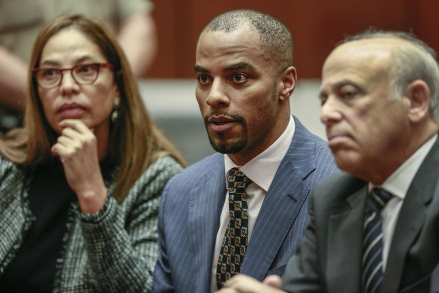 FILE - In this March 23, 2015, file photo, former NFL safety Darren Sharper, center, is flanked by his attorneys, Lisa Wayne, left, and Leonard Levine, right, in Los Angeles Superior Court. A federal judge rejected a plea deal Thursday, Feb. 18, 2016, in the rape case against the former NFL star, saying the possible nine-year sentence doesn't reflect the seriousness of the alleged crimes. (AP Photo/Nick Ut, Pool, File) **FILE**
