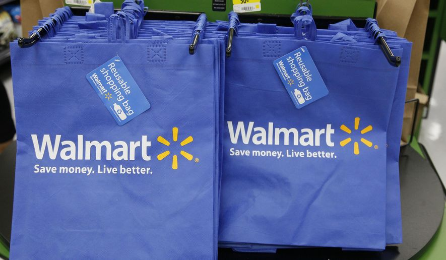 FILE - In this Thursday, Sept. 19, 2013, file photo, reusable shopping bags are offered for sale at a Wal-Mart Neighborhood Market, in the Chinatown district of Los Angeles. On Thursday, Feb. 18, 2016, Wal-Mart reports financial results. (AP Photo/Nick Ut, File)