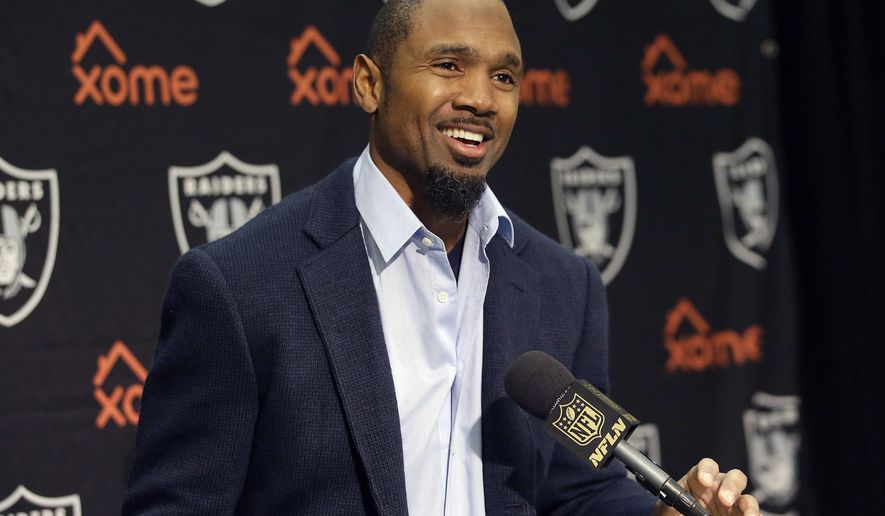 FILE - In this Dec. 24, 2015, file photo, Oakland Raiders cornerback Charles Woodson, speaks at a news conference after an NFL football game against the San Diego Chargers in Oakland, Calif. Woodson has a new role in pro football: NFL analyst for ESPN. ESPN announced Thursday, Feb. 18, 2016,  that the recently retired defensive back has been hired to work as an analyst on Sunday NFL Countdown and Monday Night Countdown. (AP Photo/Marcio Jose Sanchez), File