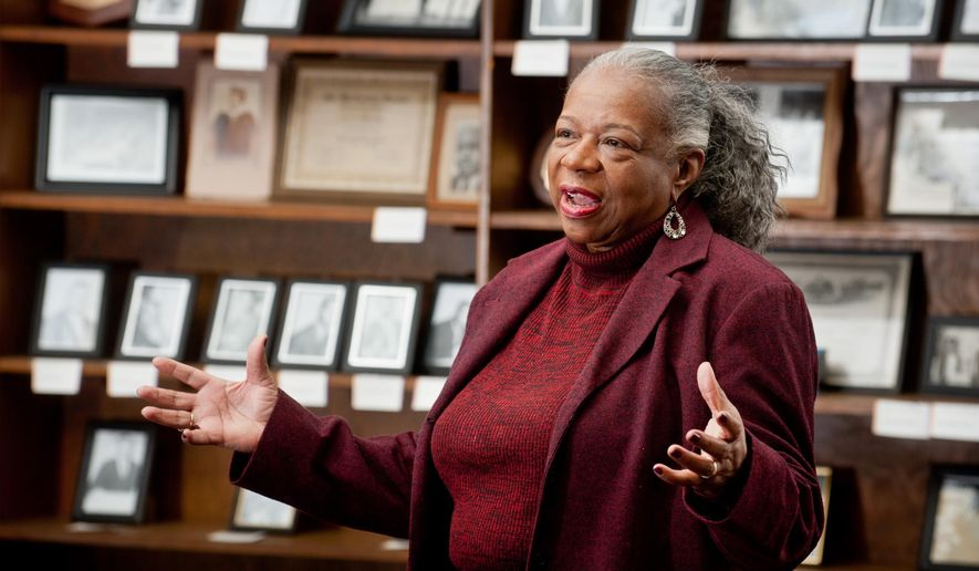 In this photo taken on Thursday, Feb. 11, 2016, H.B. Pemberton High School graduate Glenda Clay, class of 1968, speaks about the history of the school in what was once the school's library and is now Wiley College's Heritage Center, in Marshall, Texas. (Michael Cavazos/The News-Journal via AP) MANDATORY CREDIT