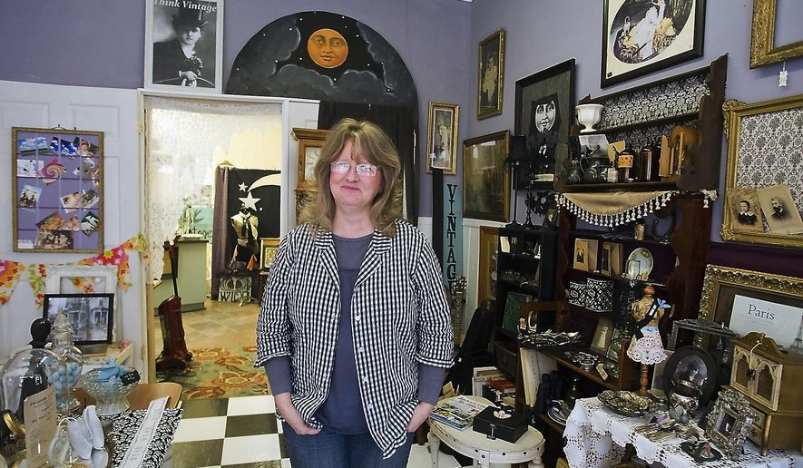 In this Feb. 3, 2016 photo, Andrea Stephens poses for a photo inside in her business, Think Vintage, in Murphysboro, Ill. Stephens returned to Southern Illinois from California where she had a similar business. Hers is one of the newest additions to the growing landscape of women-owned businesses in Murphysboro. (Richard Sitler/The Southern via AP)