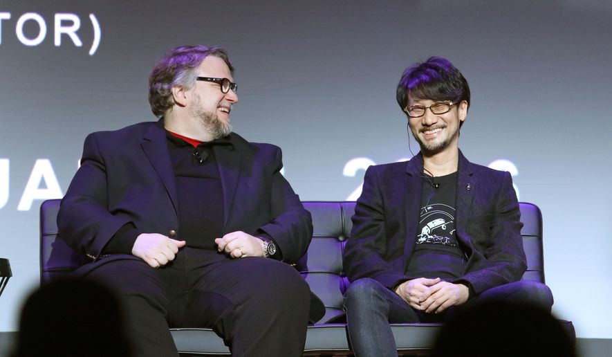 Guillermo del Toro, left, film director at DelToro Films and Hideo Kojima, game designer at Kojima Productions, share a laugh while participating in a panel discussion at the D.I.C.E. Summit Thursday, Feb. 18, 2016, in Las Vegas. (AP Photo/Ronda Churchill)