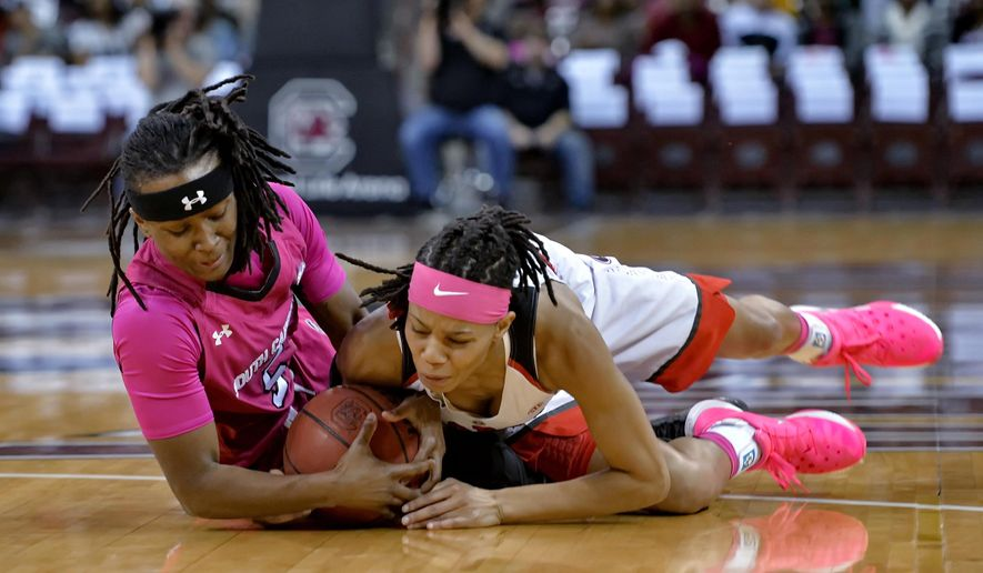 South Carolina's Khadijah Sessions, left, battles for a loose ball with Georgia's Tiaria Griffin during the first half of an NCAA college basketball game Thursday, Feb. 18, 2016,  in Columbia, S.C. (AP Photo/Richard Shiro)
