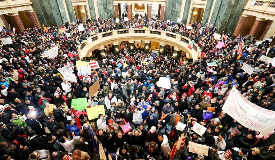Thousands of Latinos, immigrants and their supporters congregate inside the Wisconsin State Capitol in Madison, Wis. to protest legislative bills they believe to be anti-immigration Thursday, Feb. 18, 2016. (John Hart /Wisconsin State Journal via AP) MANDATORY CREDIT