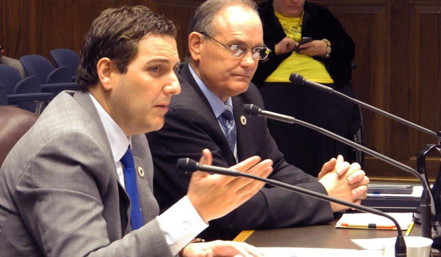 Rep. Walt Leger, D-New Orleans, left, asks lawmakers to consider doubling a state tax credit that helps the working poor, while Rep. Tony Bacala, R-Prairieville, right, asked lawmakers to consider getting rid of it, on Thursday, Feb. 18, 2016, in Baton Rouge, La. The House Ways and Means Committee didn't take action on either proposal, delaying votes until another day. (AP Photo/Melinda Deslatte)