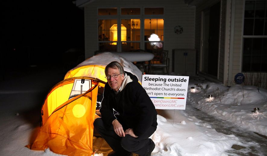 In this Feb. 16, 2016, photo, Mike Tupper, pastor of Parchment United Methodist Church, poses for a portrait by his tent outside of his home in Lawrence, Mich. Tupper said that he has been sleeping outside in his tent since Nov.30, 2015, to represent the ways in which the LGBTQ community is kept outside of the doors of the church and in the cold. Tupper plans to sleep outside for 175 nights total. (Chelsea Purgahn/Kalamazoo Gazette-MLive Media Group via AP) LOCAL TELEVISION OUT; LOCAL RADIO OUT; MANDATORY CREDIT