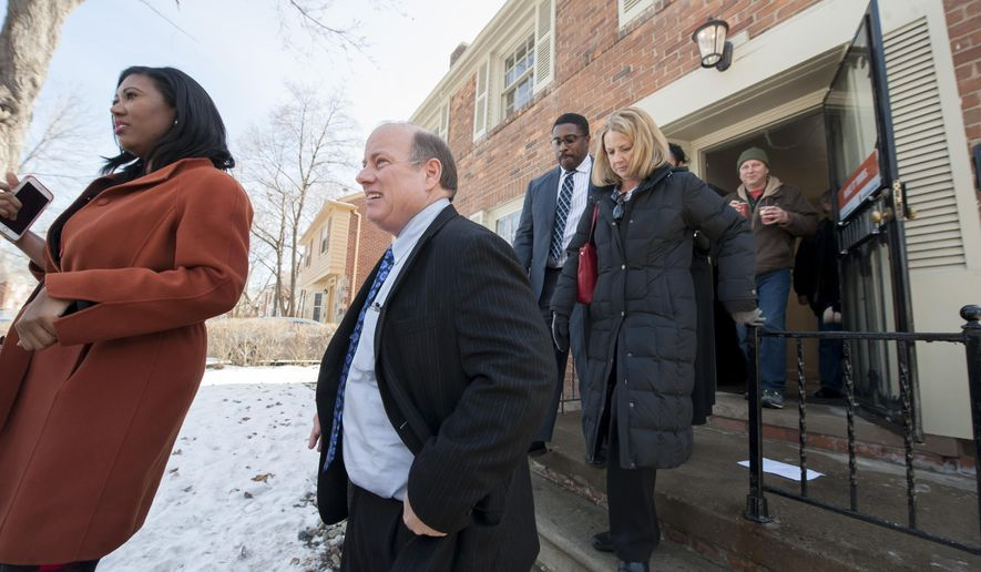 Detroit Mayor Mike Duggan comes outside after a press conference to announce a new Detroit home mortgage program in Detroit, Mich., Thursday, Feb. 18, 2016. (David Guralnick/Detroit News via AP) MANDATORY CREDIT