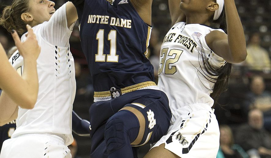 Notre Dame's Brianna Turner (11) pulls down the rebound between Wake Forest defenders Elisa Penna (41) and Milan Quinn (32) in the first half of an NCAA college basketball game Thursday,  Feb. 18, 2016, in Winston-Salem, N.C. (AP Photo/Lynn Hey)