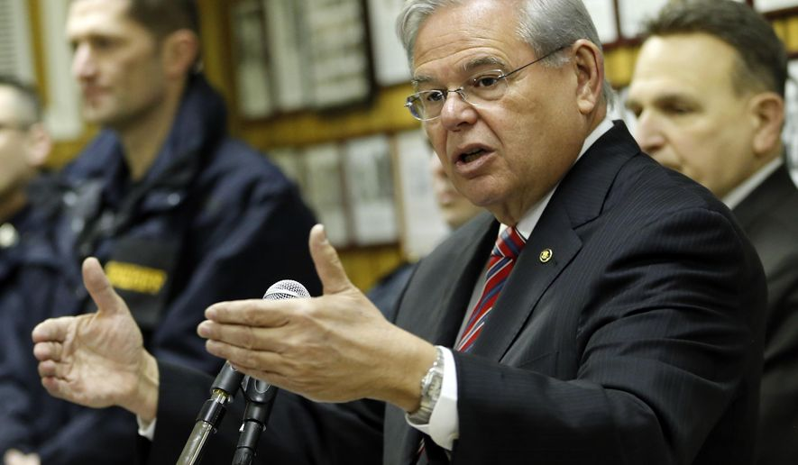 U.S. Sen. Bob Menendez (D-NJ) speaks about President Barack Obama's planned trip to Cuba during a news conference, Thursday, Feb. 18, 2016, in Union City, N.J. Obama said Thursday he'll raise human rights issues and other U.S. concerns with Cuban President Raul Castro during a history-making visit to the communist island nation. The brief visit in mid-March will mark a watershed moment in relations between the U.S. and Cuba, making Obama the first sitting U.S. president to set foot on the island in nearly seven decades. (AP Photo/Julio Cortez)