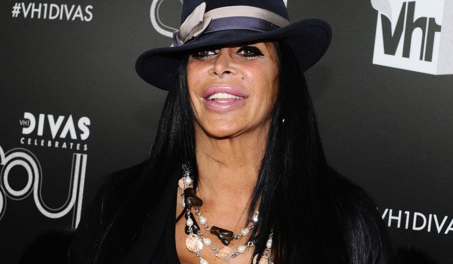 "FILE - In this Dec. 18, 2011, file photo, Angela Raiola, better known as Big Ang, arrives at ""Vh1 Divas Celebrates Soul"" in New York. Raiola from the reality TV series ""Mob Wives"" has died following a nearly yearlong battle with cancer, series producer Jennifer Graziano said Thursday, Feb. 18, 2016. (AP Photo/Charles Sykes, File)"