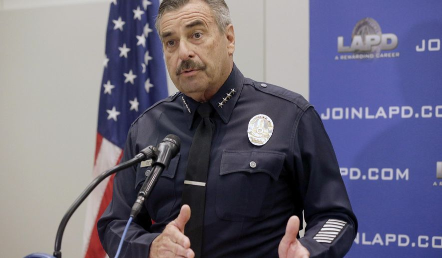 Los Angeles Police Chief Charlie Beck takes questions from the media at news conference at the LAPD headquarters downton Los Angeles on Wednesday, Feb. 17, 2016. Two Los Angeles police officers have been arrested and charged with repeatedly raping four women while on duty over a three-year period. The charges against Officers James Nichols and Luis Valenzuela were announced Wednesday and include rape under color of authority and oral copulation by force. Beck said that both officers have been suspended without pay since 2013. (AP Photo/Nick Ut)