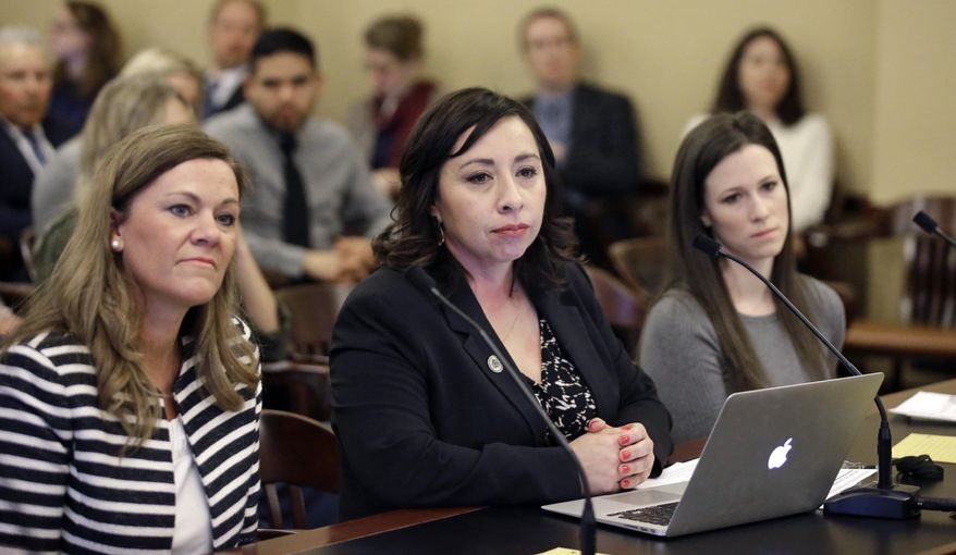 Salt Lake City Democrat Rep. Angela Romero, center, prepares to testify as Melissa Ridgway Kraft, left, and Stephanie Pitcher look on at the Utah State Capitol Thursday, Feb. 18, 2016, in Salt Lake City. A plan to give state and higher education workers six weeks paid time off when they become new parents appears to be dead for the year after lawmakers sited confusion over its estimated cost. Members of a business committee voted 9-1 in favor of studying the plan in the legislative session's off season and possibly introducing it again next year. (AP Photo/Rick Bowmer)