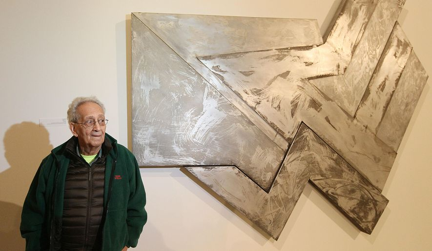 "U.S. artist Frank Stella poses in front of one of his works at an exhibition devoted to him in Warsaw, Poland, Thursday, Feb. 18, 2016. ""Frank Stella and the Synagogues of Historic Poland"" opens Friday at the POLIN Museum of the History of Polish Jews and will run through June 20. It showcases abstract works that he created in the 1970s which were inspired by pre-World War II wooden synagogues in Poland. (AP Photo/Czarek Sokolowski)"