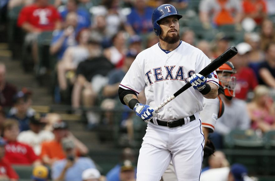 FILE - In this Friday, July 31, 2015 file photo, Texas Rangers' Josh Hamilton during an at bat against the San Francisco Giants in a baseball game in Arlington, Texas. Texas Rangers outfielder Josh Hamilton said Thursday, Feb. 18, 2016 he is dealing with soreness in his left knee after a second surgery. (AP Photo/Tony Gutierrez, File)