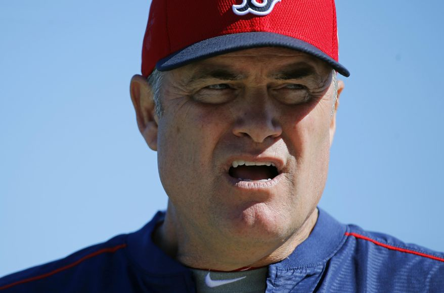 Boston Red Sox manager John Farrell walks on a field during a spring training baseball practice in Fort Myers, Fla., Thursday, Feb. 18, 2016. Red Sox pitchers and catchers hold their first official workout on Friday. (AP Photo/Patrick Semansky)