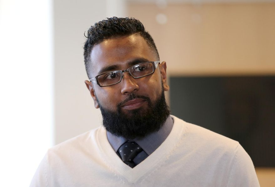 Didarul Sarder, 32, of Warren, Mich., arrives at the Warren City Hall where he was honored by Warren Mayor Jim Fouts on Thursday, Feb. 18, 2016. Fouts holds ceremony to honor Didarul Sarder for intervening in the stabbing of a GM Tech Center employee. (Jessica J. Trevino/Detroit Free Press. (Jessica Trevino/Detroit Free Press via AP) MANDATORY CREDIT