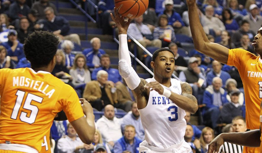 Kentucky's Tyler Ulis (3) passes between Tennessee's Detrick Mostella (15) and Kevin Punter during the first half of an NCAA college basketball game Thursday, Feb. 18, 2016, in Lexington, Ky. (AP Photo/James Crisp)