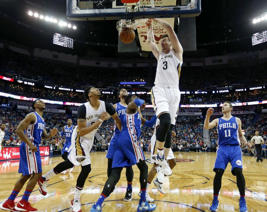 New Orleans Pelicans center Omer Asik dunks during the first half of the team's NBA basketball game against the Philadelphia 76ers in New Orleans, Friday, Feb. 19, 2016. (AP Photo/Gerald Herbert)