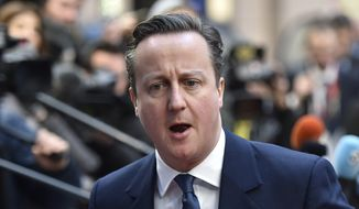 British Prime Minister David Cameron arrives for an EU summit at the EU Council building in Brussels on Friday, Feb. 19, 2016. Cameron faces tough new talks with European partners after through-the-night meetings failed to make much progress on his demands for a less intrusive European Union.  (AP Photo/Martin Meissner)