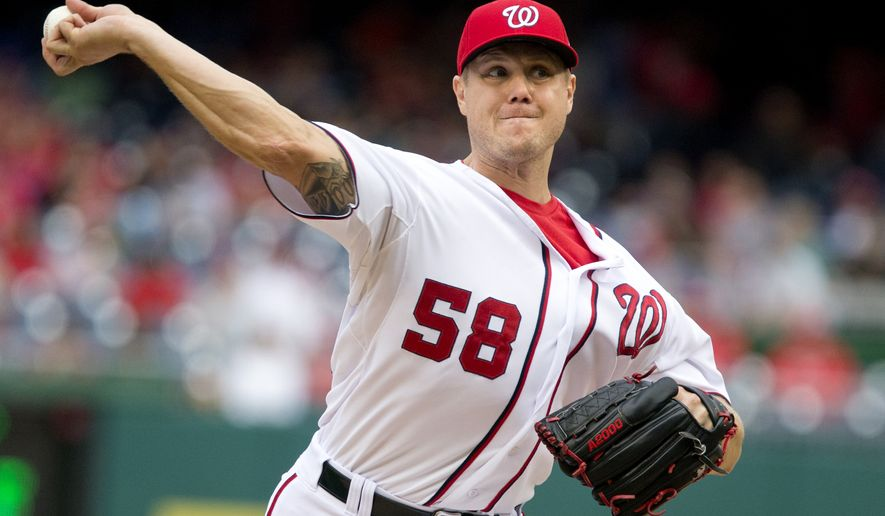 FILE - In this Sept. 27, 2015 file photo, Washington Nationals relief pitcher Jonathan Papelbon pitches against the Philadelphia Phillies at Nationals Park in Washington. expressed remorse for grabbing teammate Bryce Harper by the throat during scuffle in the dugout in September and said he is on good terms with the Washington Nationals' superstar outfielder. (AP Photo/Jacquelyn Martin, file)
