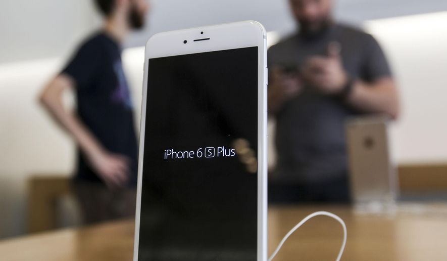 An Apple iPhone 6s Plus smartphone is displayed Friday, Sept. 25, 2015 at the Apple store at The Grove in Los Angeles.  On Wednesday, Feb. 17, 2016, a federal judge ordered Apple Inc. to help the FBI hack into an encrypted iPhone used by Syed Farook, who along with his wife, Tashfeen Malik, killed 14 people in December in the worst terror attack on U.S. soil since Sept. 11, 2001.  Apple has helped the government before in this and previous cases, but this time Apple CEO Tim Cook said no and Apple is appealing the order. (AP Photo/Ringo H.W. Chiu)