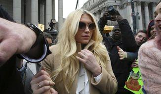 Pop star Kesha leaves Supreme court in New York, Friday, Feb. 19, 2016. (AP Photo/Mary Altaffer)