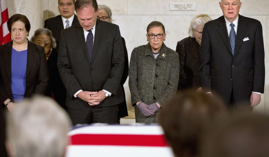 Supreme Court Justices, from left, Elena Kagan, Samuel Anthony Alito, Jr., Ruth Bader Ginsburg, and Anthony Kennedy participate in prayers at a private ceremony in the Great Hall of the Supreme Court in Washington, Friday, Feb. 19, 2016, where late Supreme Court Justice Antonin Scalia lies in repose. (AP Photo/Jacquelyn Martin, Pool)