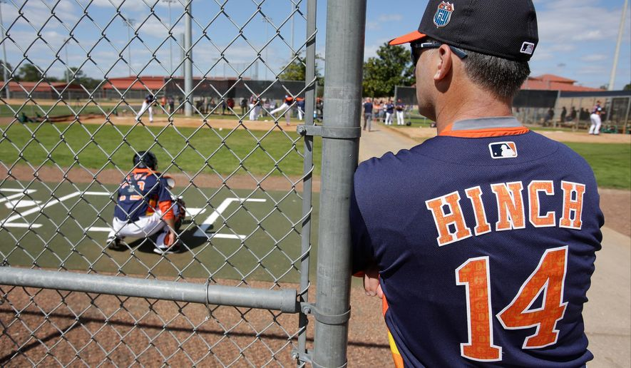 Houston Astros manager A.J. Hinch (14) watches catchers and pitchers during a spring training baseball workout, Friday, Feb. 19, 2016, in Kissimmee, Fla. (AP Photo/John Raoux)