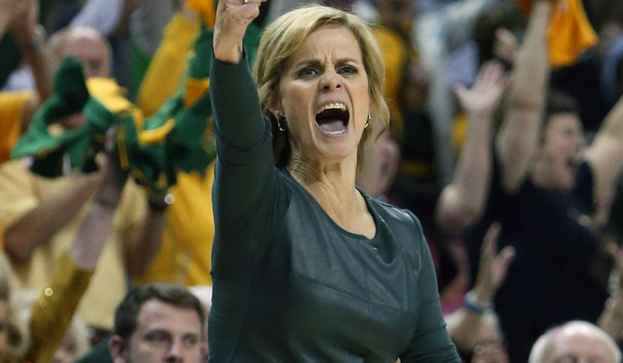FILE - In this Feb. 17, 2016, file photo, Baylor head coach Kim Mulkey reacts to a play against Oklahoma State in the second half of an NCAA college basketball game, in Waco, Texas. While under the radar nationally, even with two national championships under coach Kim Mulkey, the No. 4 Lady Bears are again leading the Big 12 and trying to win their sixth consecutive conference title.  (AP Photo/Jerry Larson, File)