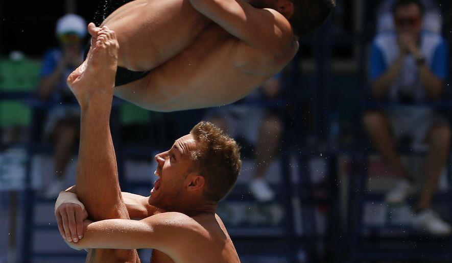 U.S. athletes Sam Dorman and Kristian Ipsen dive in the men's synchronized 3 meter springboard during the FINA World Diving Cup, at the Maria Lenk Aquatics Center in Rio de Janeiro, Brazil, Friday, Feb. 19, 2016. (AP Photo/Leo Correa)