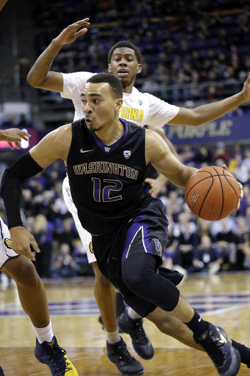 Washington's Andrew Andrews (12) drives in front of California's Tyrone Wallace during the first half of an NCAA college basketball game Thursday, Feb. 18, 2016, in Seattle. (AP Photo/Elaine Thompson)