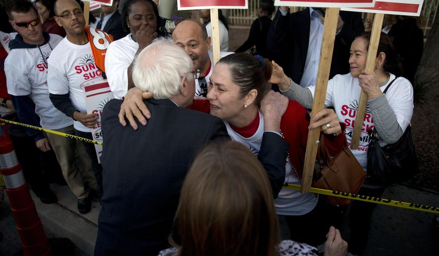 Democratic presidential candidate Sen. Bernie Sanders, I-Vt., left, hugs a culinary worker protesting outside Sunrise Hospital Thursday, Feb. 18, 2016, in Las Vegas. Hillary Clinton has the edge over her Democratic presidential rival, Sanders, when it comes to scoring endorsements from unions. But what about union members? Sanders is running hard to capture the votes of rank and file members even as their leadership joins the Clinton bandwagon. (AP Photo/Jae C. Hong)