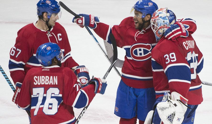 Montreal Canadiens goaltender Mike Condon is congratulated by teammates Max Pacioretty (67), P.K.Subban (76) and Devante Smith-Pelly (21) after the Canadiens defeated the Philadelphia Fyers in a NHL shootout in an NHL hockey game Friday, Feb. 19, 2016, in Montreal. (Graham Hughes/The Canadian Press via AP)